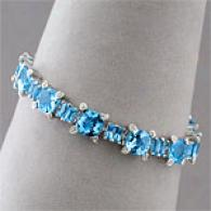 14k Gold 31.99 Cttw. Blue Topaz & Diamond Bracelet