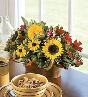 Our Exclusive Wreath And Centerpiece Are Down-to-earth Combination Of